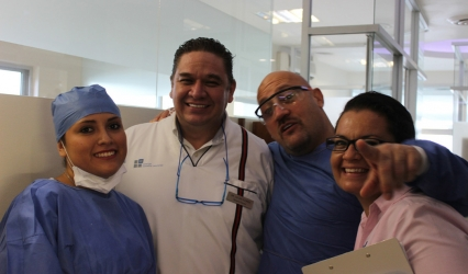 Dr German Arzate's specialist team on Live Implant Surgery Maxicourse in Cancun by the American Academy of Implant Dentistry and the Dental Implant Learning Center at Englewood.